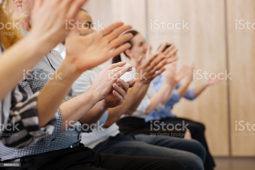 Close up of peoples hands applauding stock photo