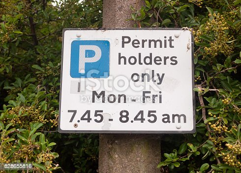 istock close up of permit holders only parking sign 828655816