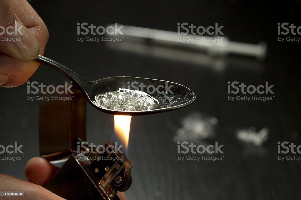 Close up of person cooking heroin stock photo