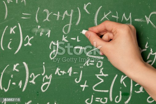 istock Close up of person writing mathematical equation on chalkboard 183883115