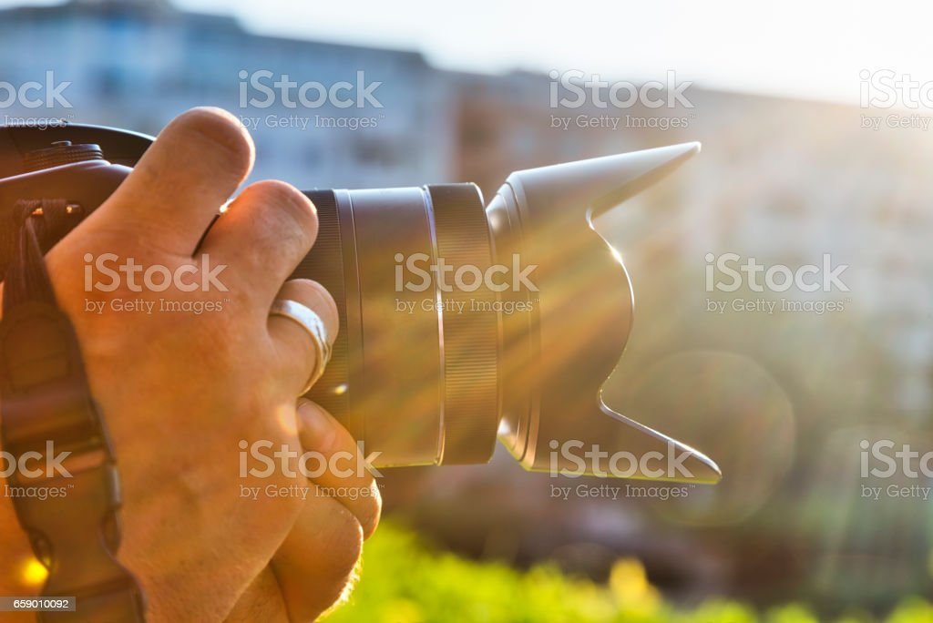 close up of photographers hands with camera royalty-free stock photo
