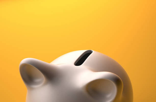 close up of piggybank high angle view over orange background - piggy bank stock photos and pictures