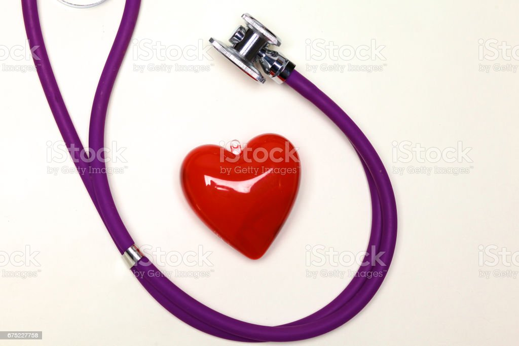 Close up of pills spread over the table with stethoscope and heart lying beside royalty-free stock photo
