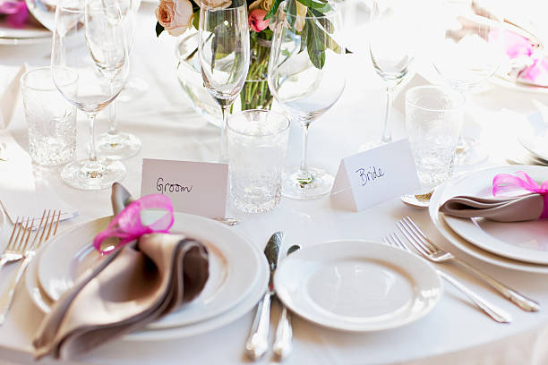 Close up of place setting at wedding reception stock photo