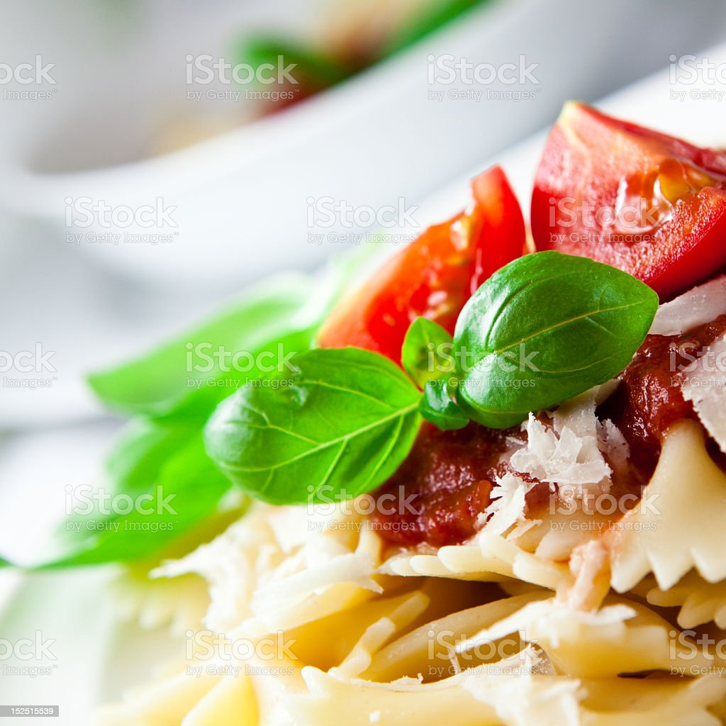 Close Up Of Plated Pasta Topped With Tomatoes and Sauce stock photo