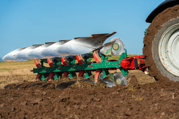 Close up of ploughing in a field in Dumfries and Galloway south west Scotland A plough being used in late summer to prepare a field and make it ready to sow a new crop to harvest next year johnfscott stock pictures, royalty-free photos & images