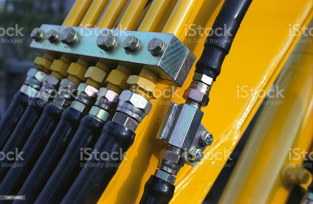 Close up of pneumatics on a yellow machine stock photo