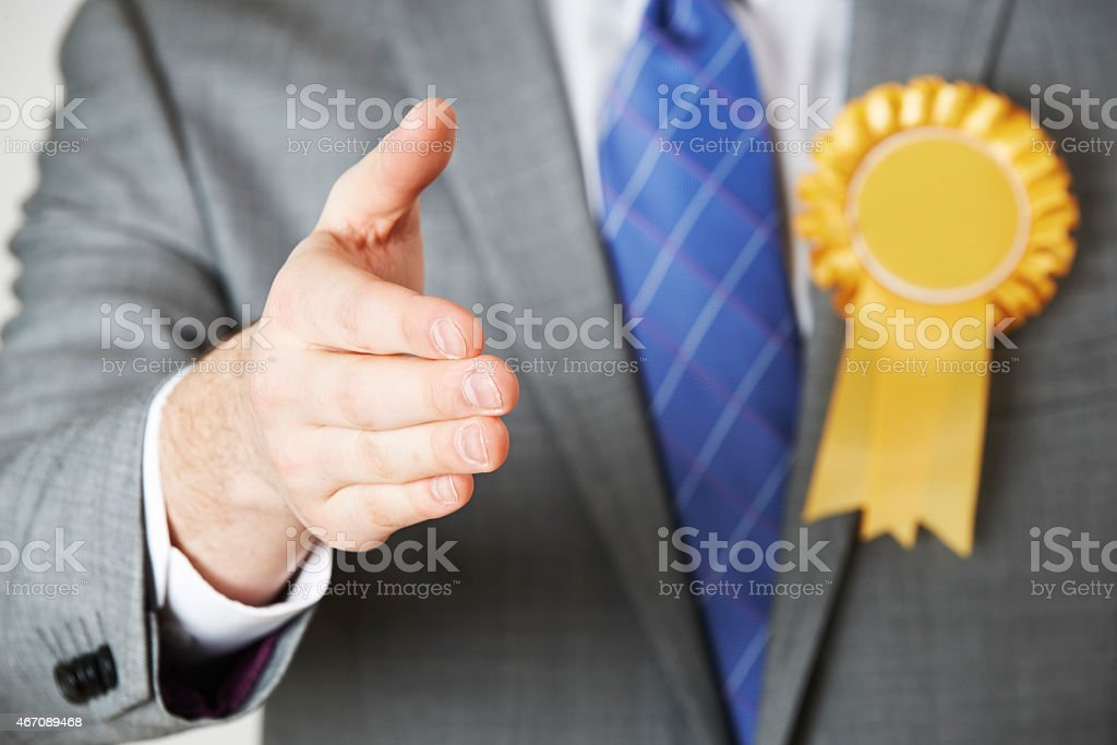 Close Up Of Politician Reaching Out To Shake Hands stock photo