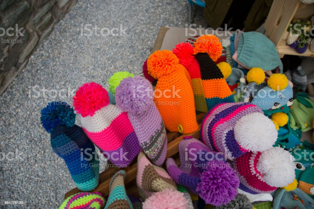close up of pompoms and colorful hats stock photo