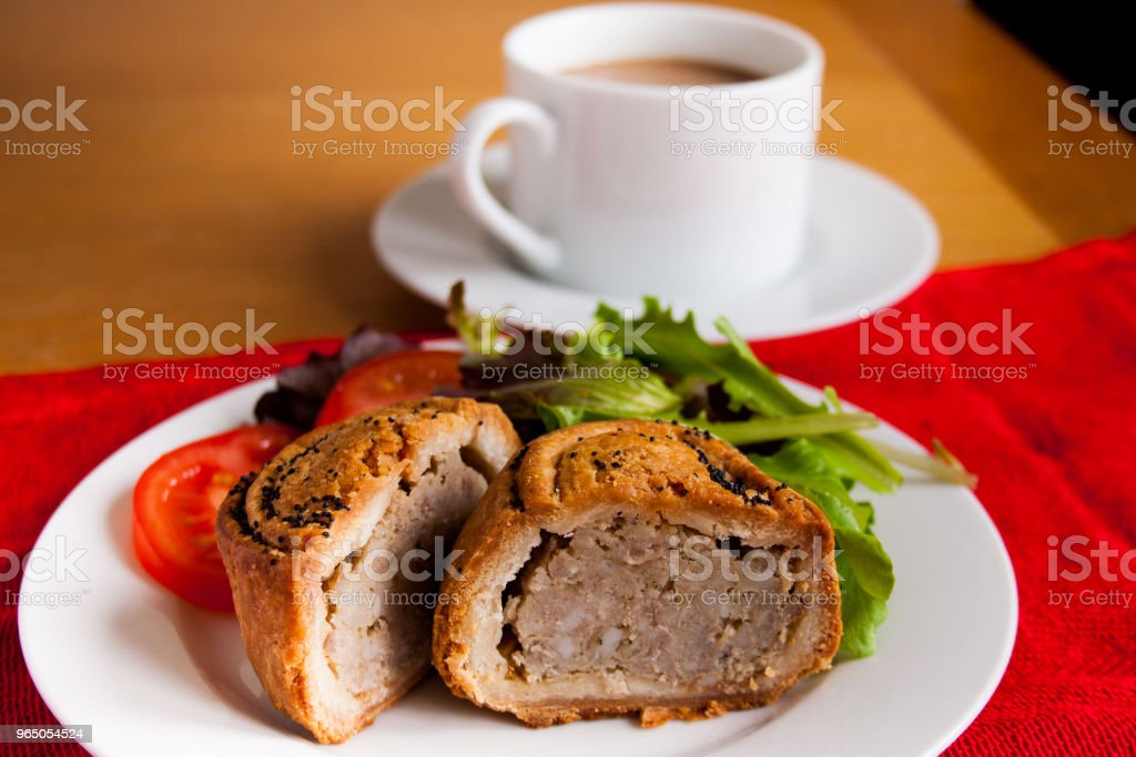 Close up of pork and bramley apple pie with salad and hot drink zbiór zdjęć royalty-free