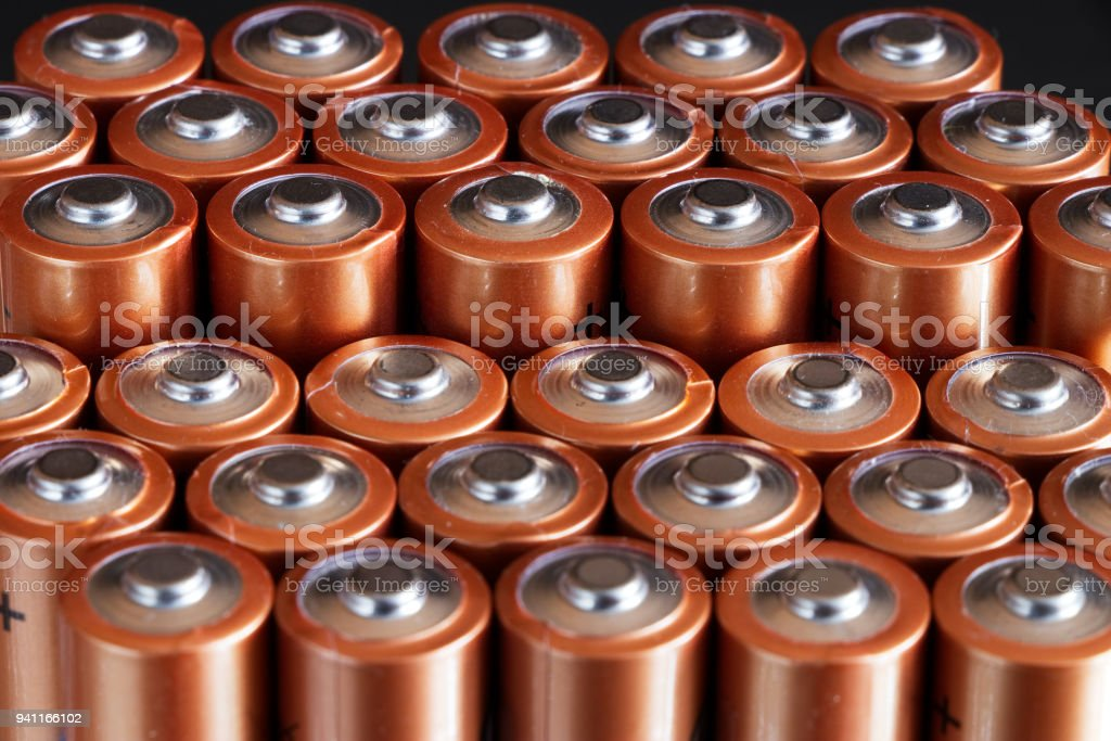 Close up of positive ends of AA batteries, recycle concept stock photo