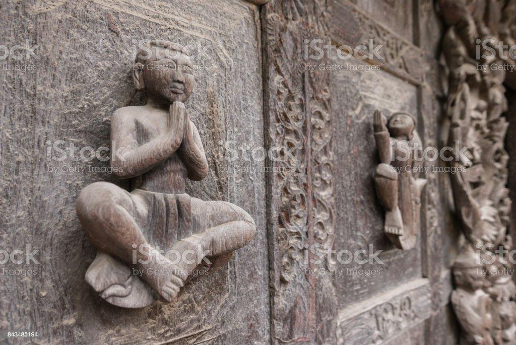 Close Up of Praying Figure on Exterior Wall, Shwenandaw Monastery, Mandalay, Myanmar (Burma) stock photo