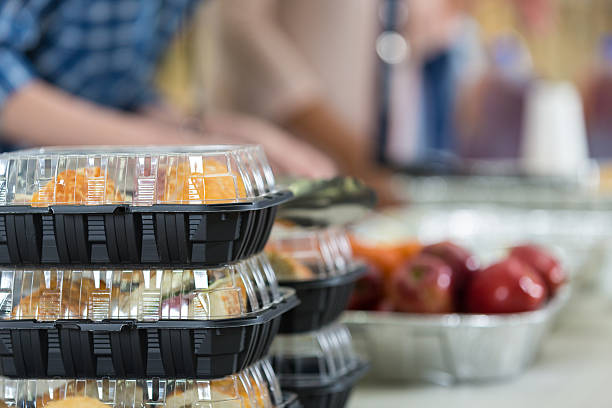 close up of prepacked food and fruit in soup kitchen - gemaksvoedsel stockfoto's en -beelden