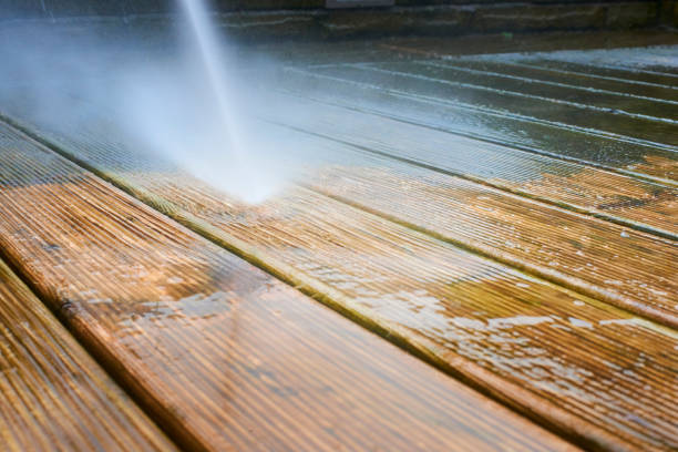 close up of pressure washer cleaning decking - high pressure cleaning stock photos and pictures