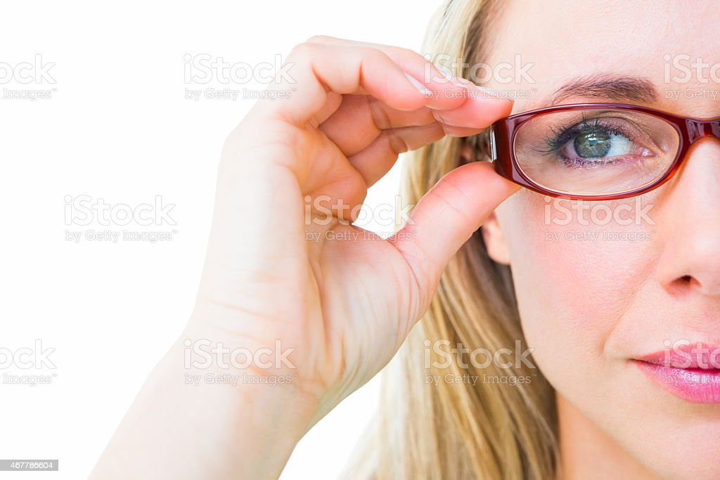 Close up of pretty blonde with red reading glasses stock photo