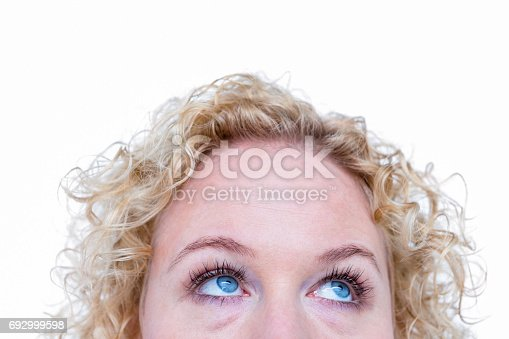 Close up of pretty blond woman looking up on white background