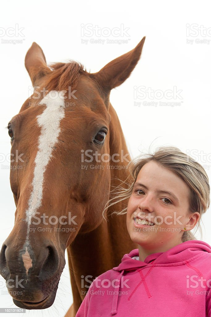 Close up of pretty girl and beautiful chestnut horse royalty-free stock photo