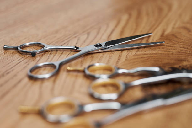 Close up of professional scissors in hair salon Close up of professional scissors in hair salon hair cut scissors stock pictures, royalty-free photos & images