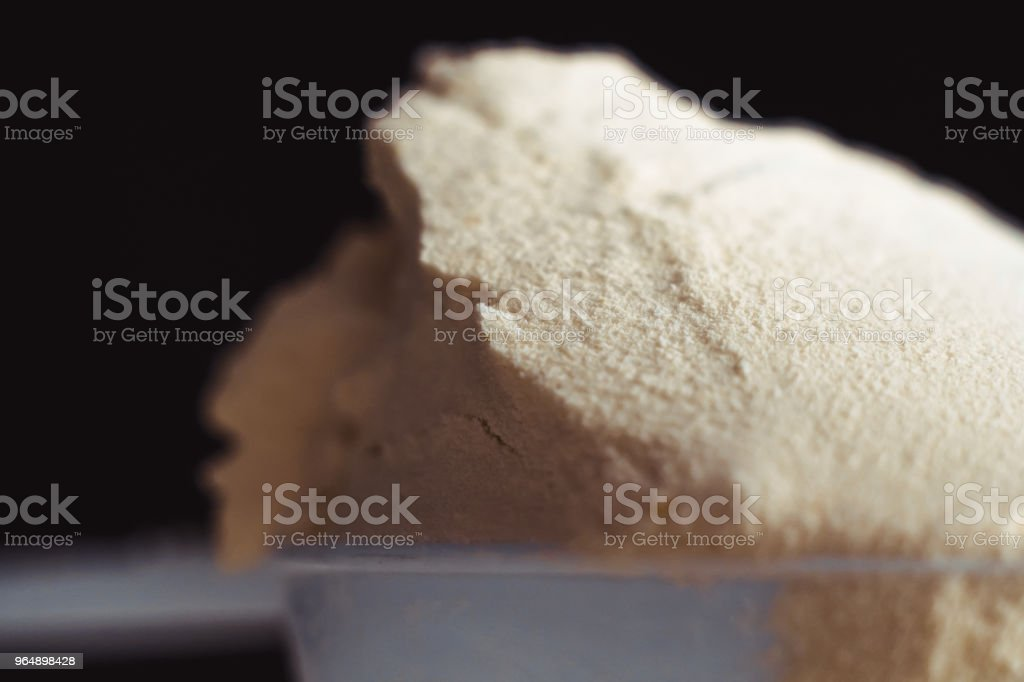 Close up of protein powder and scoops royalty-free stock photo