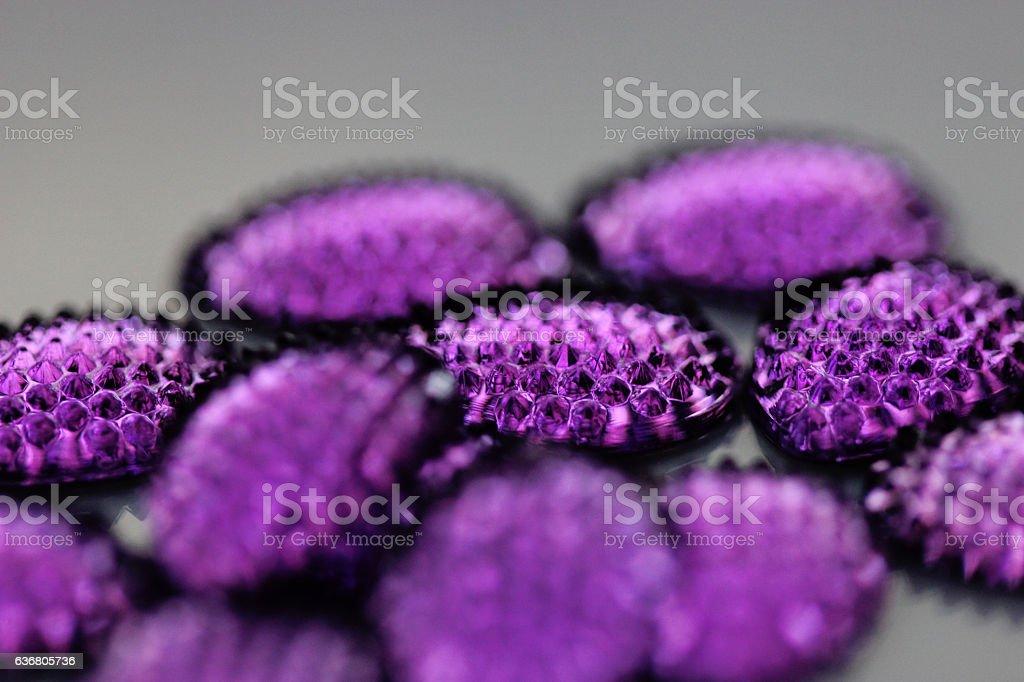 Close up of purple jewel or gem - sapphire type stock photo