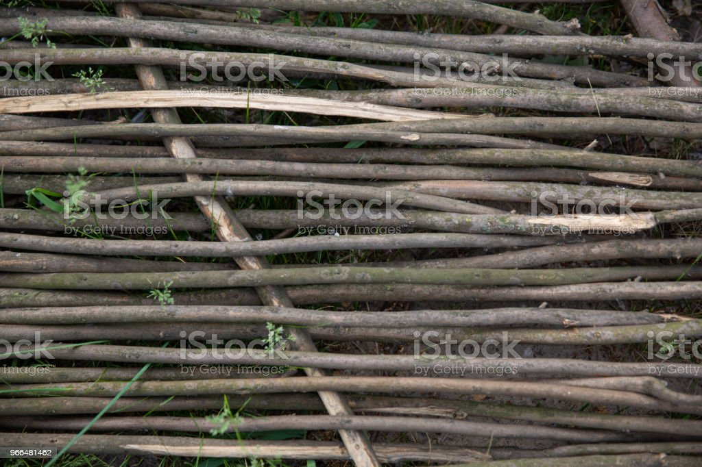 Close up of rattan on blue sky. Closeup of weaving rattan. Wallpaper of vine weaving wall. stock photo