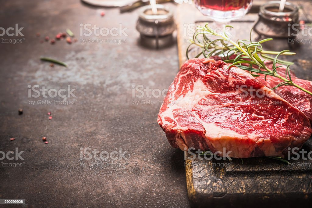 Close up of raw meat Ribeye Steak with spices stock photo