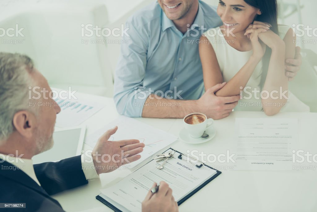 Close up of real estate agent giving consultation to family couple stock photo