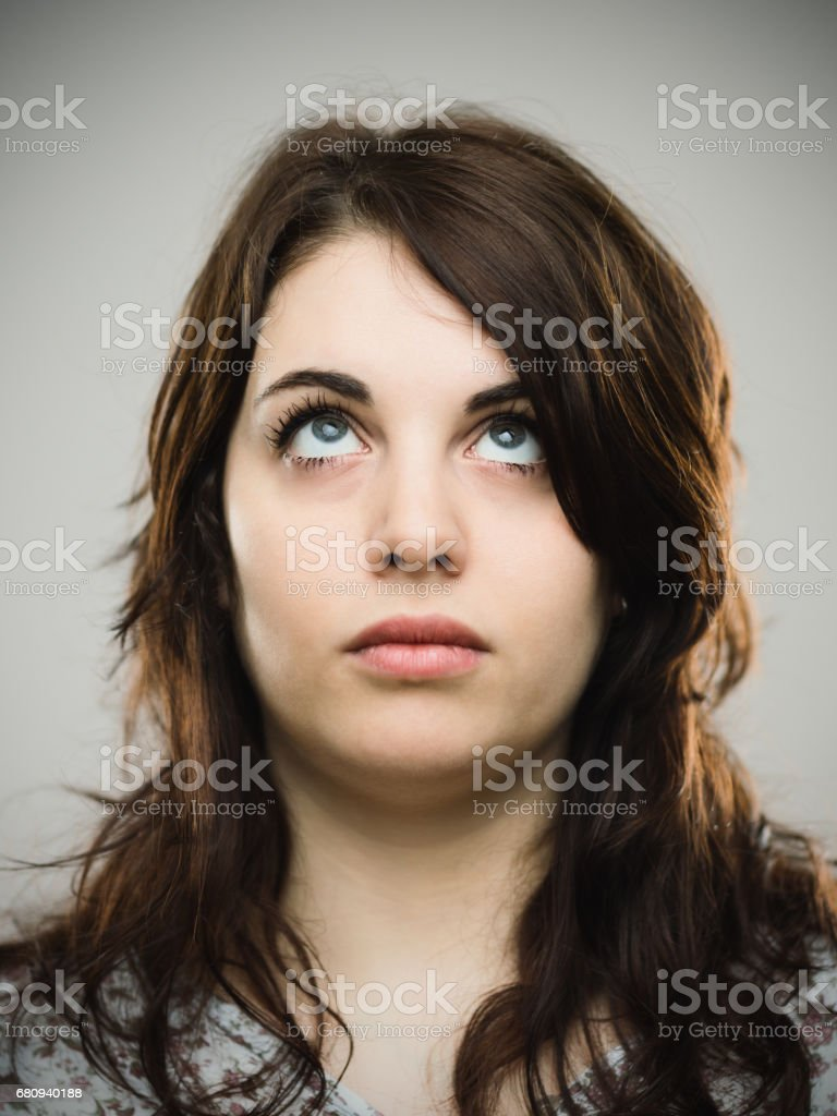 Close up of real young woman looking up royalty-free stock photo