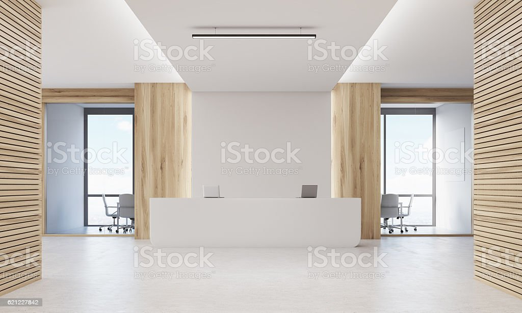 Close up of reception desk in light wood corridor stock photo