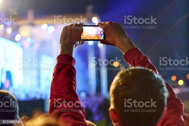 Close up of recording video with smartphone during a concert picture id512436216?b=1&k=6&m=512436216&s=612x612&h=bnhp4xvnbac4hcztm9qw3njdavyep0vb7k1ikyqrkpg=