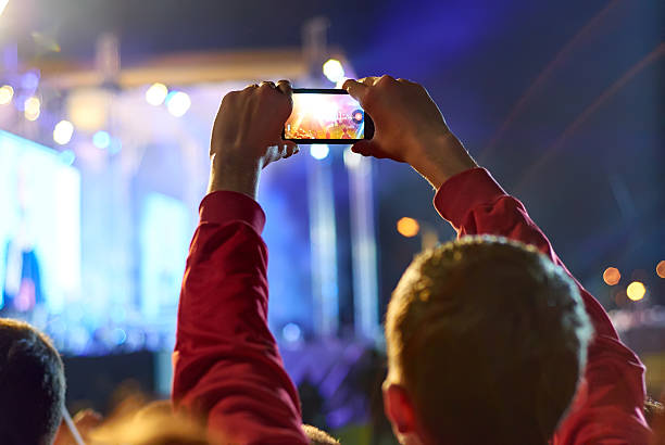 close up of recording video with smartphone during a concert. - video call bildbanksfoton och bilder