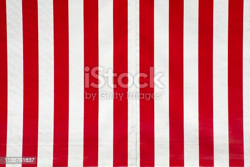 Close up of red and white striped canvas. Full frame horizontal view suitable for background purposes.