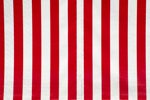Close up of red and white striped canvas.