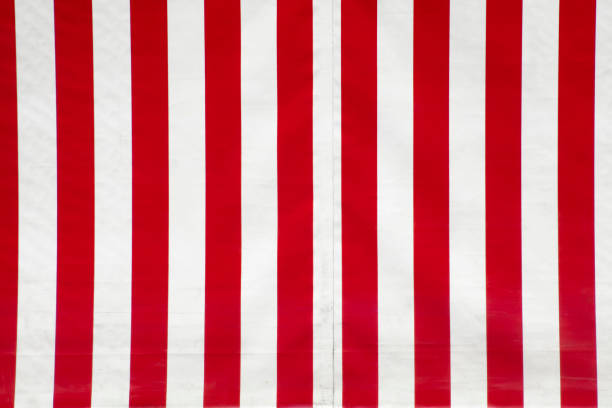 close up of red and white striped canvas. - circus background stock photos and pictures