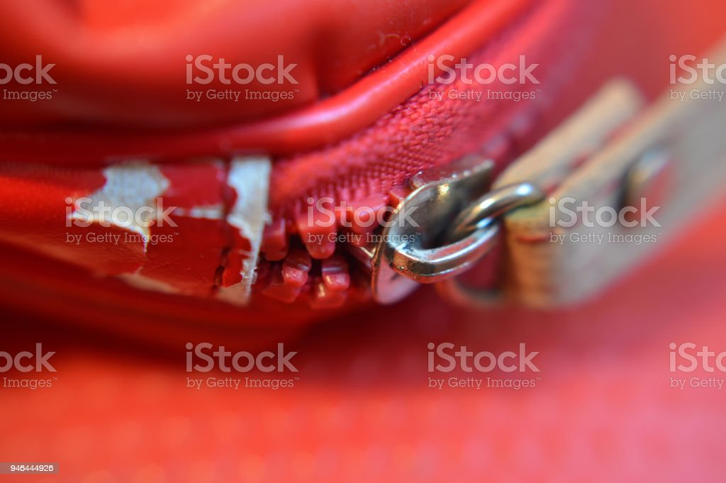 Close up of red broken bag zipper stock photo