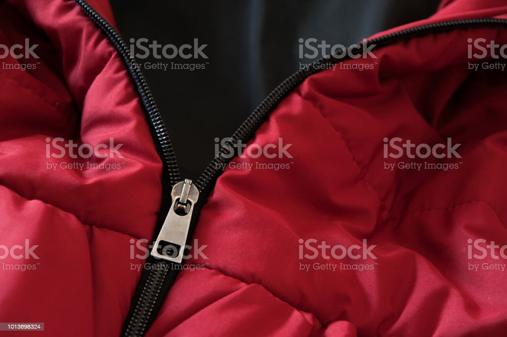 Close up of red down jacket, winter fashion outfit Close up of red down jacket, winter fashion outfit Albania Stock Photo