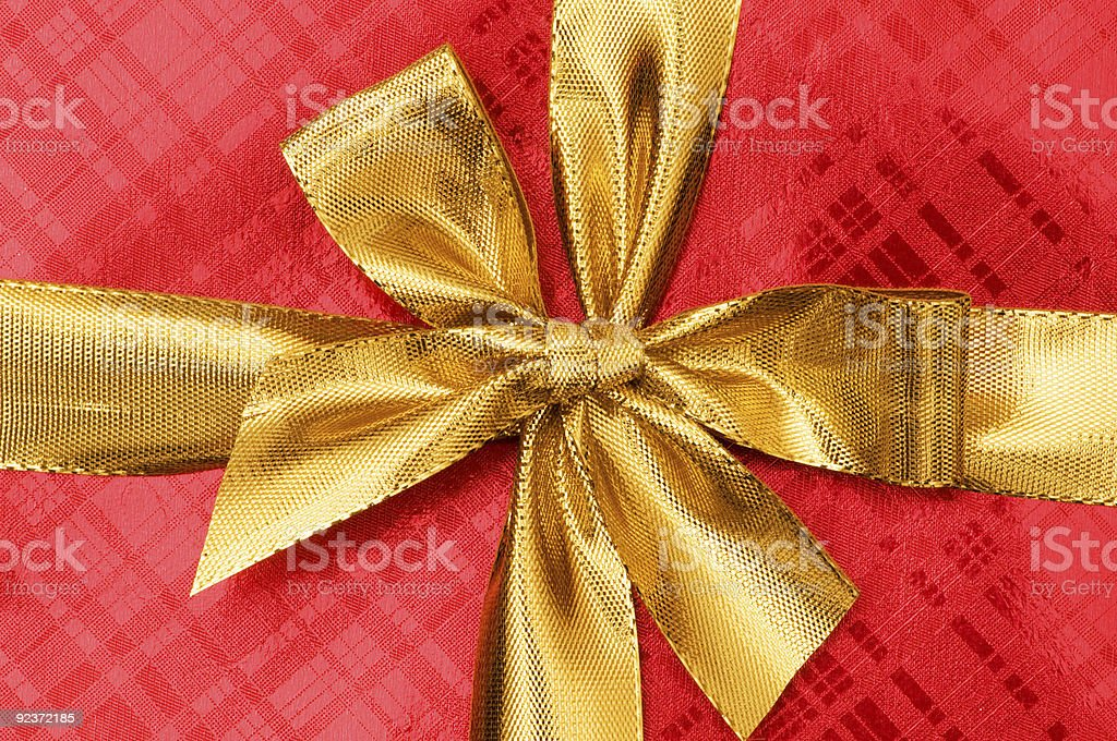 Close up of red gift box with golden ribbon royalty-free stock photo