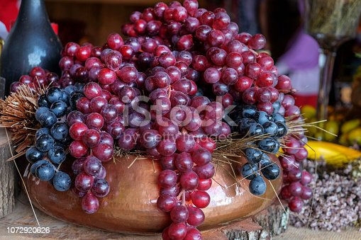 Close up bunch of grapes on brass fruit bowl