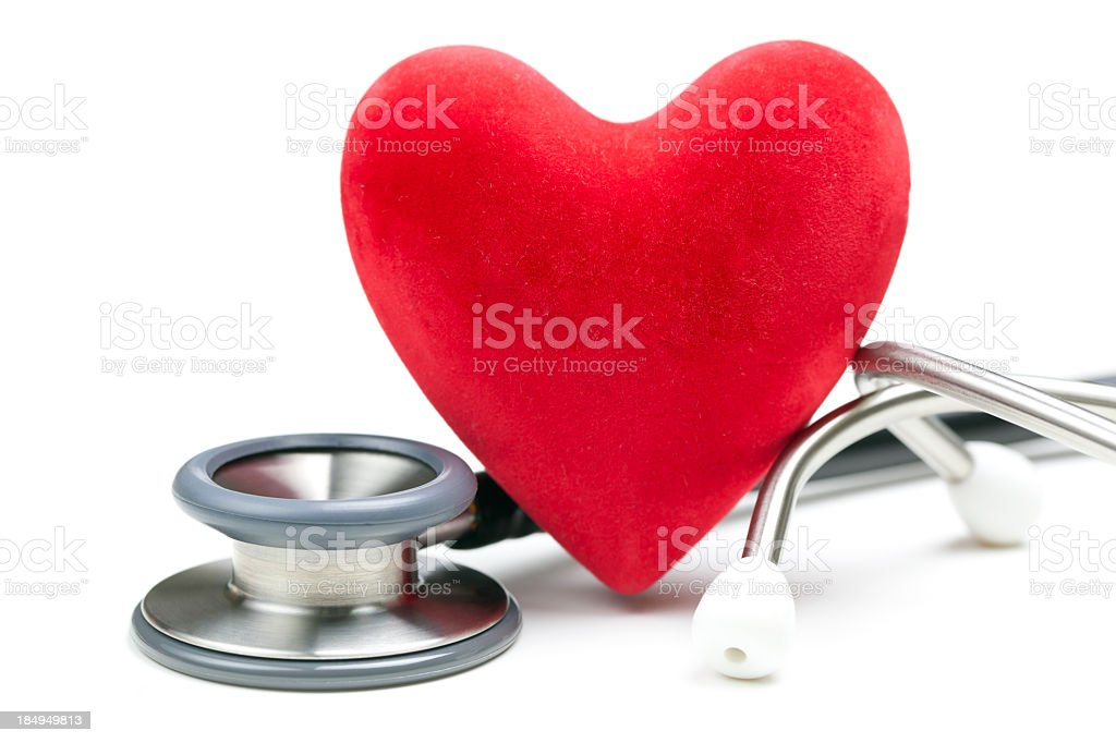Close up of red heart and silver stethoscope stock photo