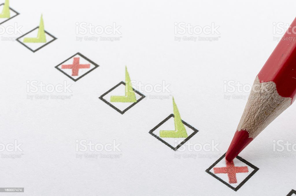Close up of red pencil marking checkbox with a cross stock photo