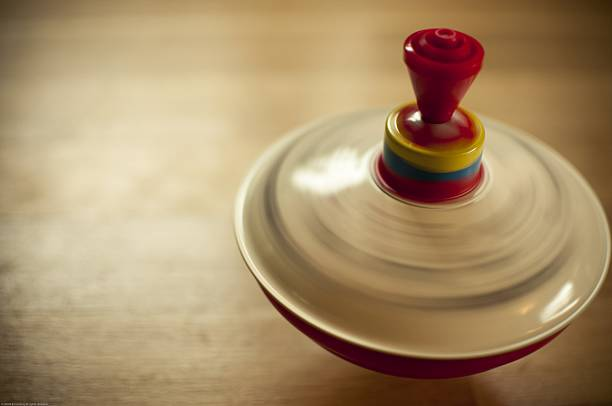 Close up of red, yellow, and blue spinning top in motion stock photo