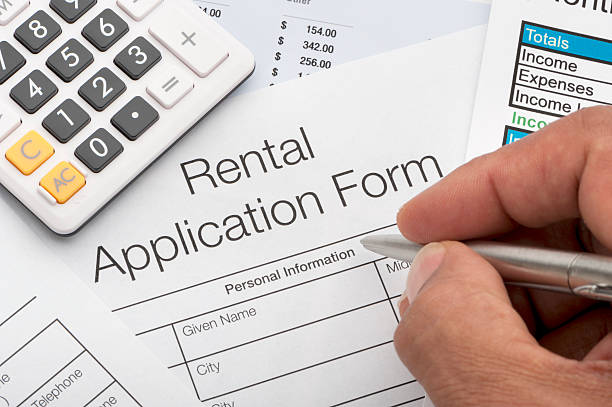 Close up of rental application Close up of rental application with calculator and pen with writing hand application form stock pictures, royalty-free photos & images