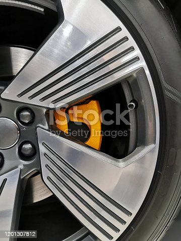 907671144 istock photo Close up of rims from a sports car 1201307812