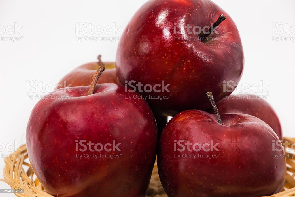 Close up of ripe red apples in wicker basket stock photo