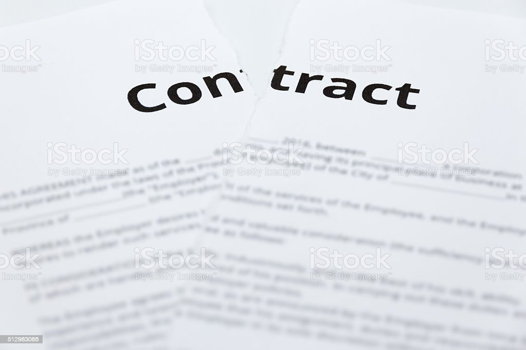 Close up of ripped up contract stock photo