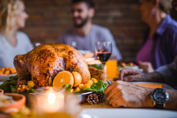 close up of roasted turkey on family's' dining table. - thanksgiving стоковые фото и изображения