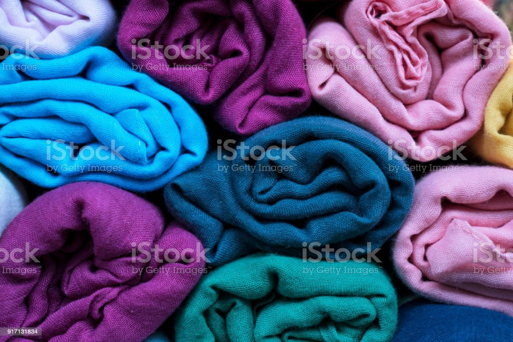 close up of rolled colorful clothes stock photo