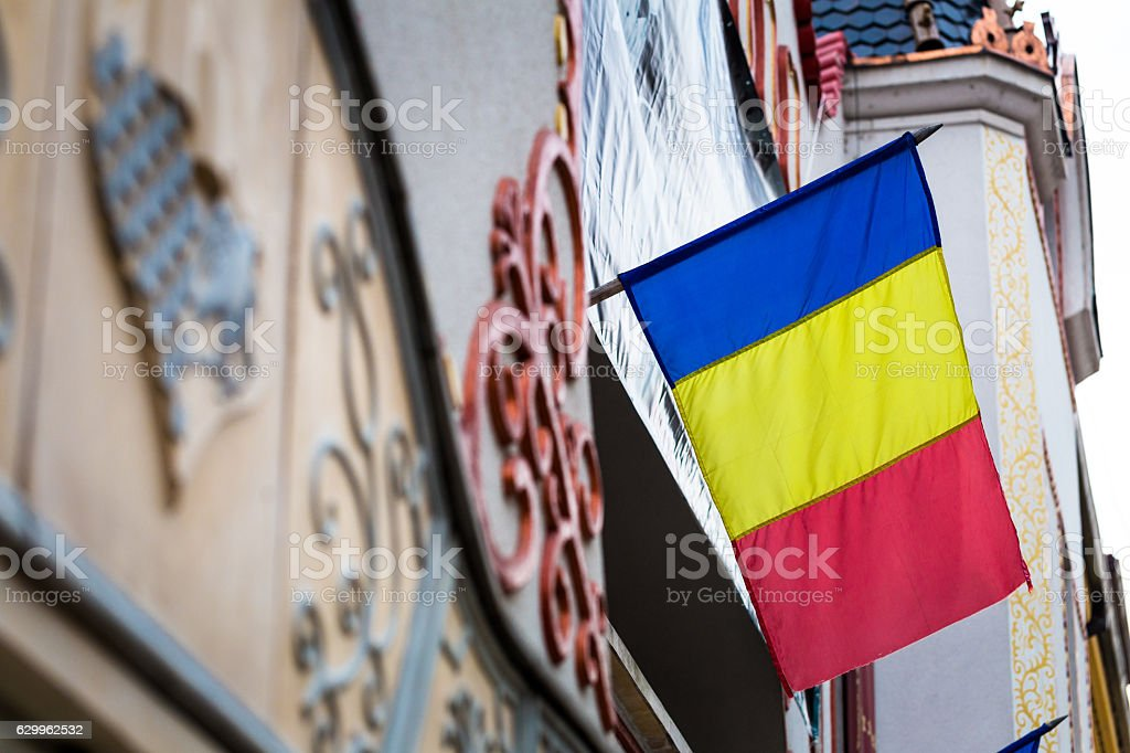 Close up of Romanian Flag attached to a building stock photo