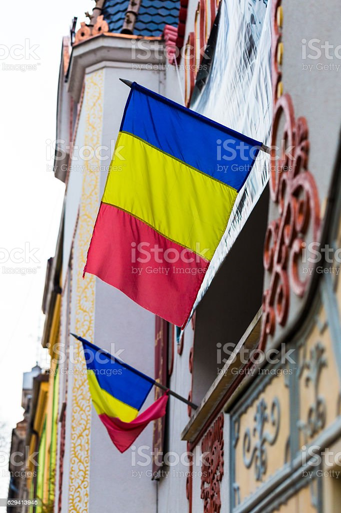 Close up of Romanian Flags attached to a building stock photo