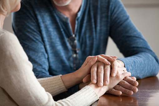 Close Up Of Romantic Aged Couple Holding Hands Caressing Stock Photo - Download Image Now